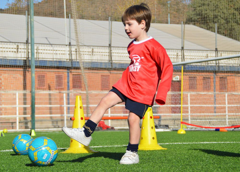A Forje Program student hits the ball during a workout